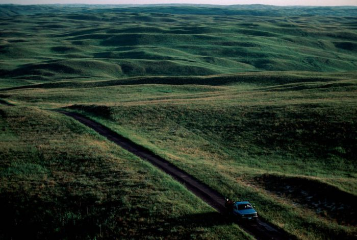 Photo: A pickup truck winds its way through the Nebraska Sandhills.