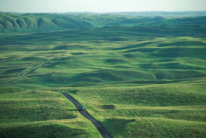 Photo: A truck driving through the Sandhills in Nebraska.