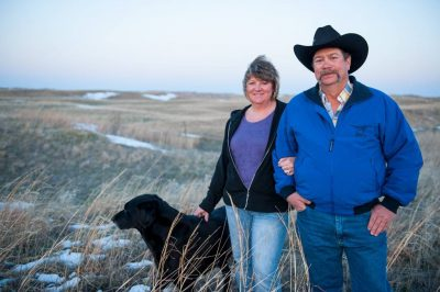 Photo: A couple pose with their dog at their ranch in the Nebraska Sandhills.