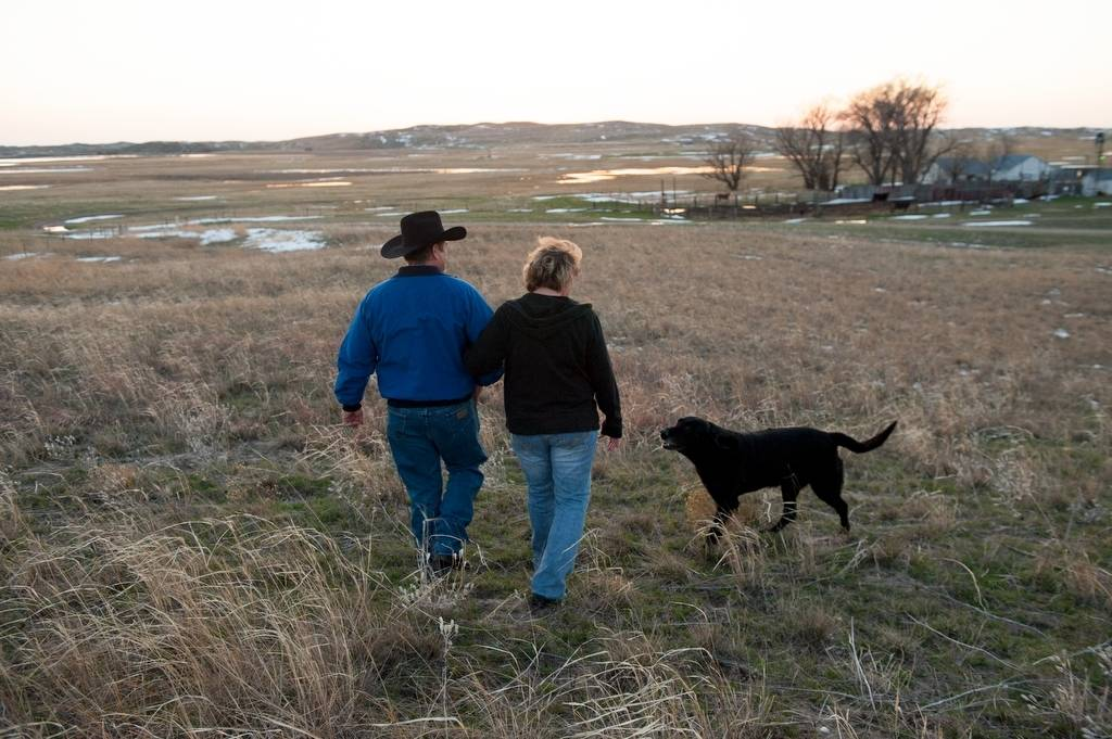 Photo: A couple walk with their dog at their ranch in the Nebraska Sandhills.
