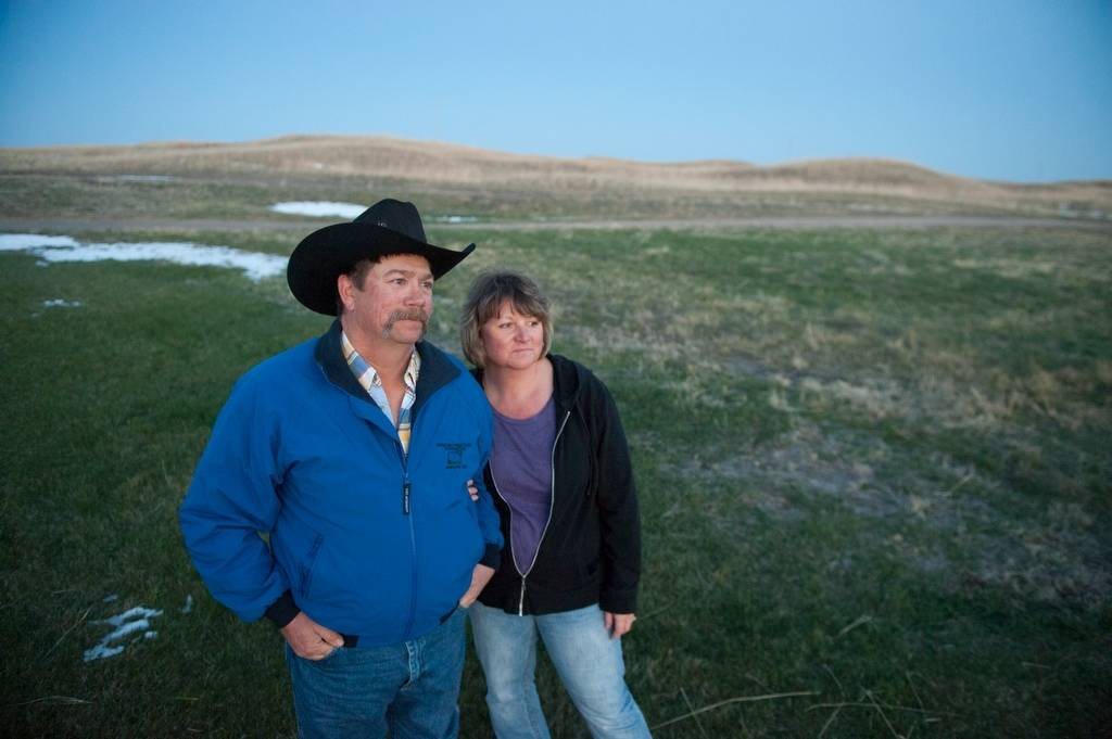 Photo: A couple over look their ranch in the Nebraska Sandhills.