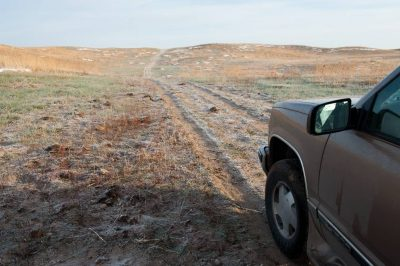 Photo: A truck prepares to drive through some ranch land in the Nebraska Sandhills.