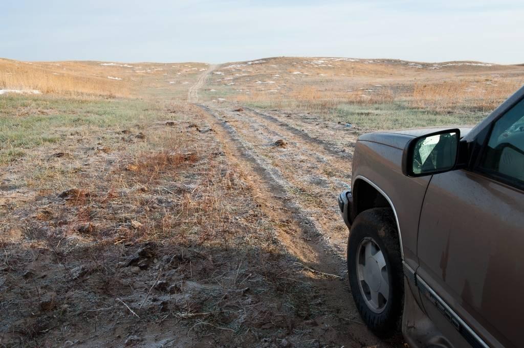 Photo: A truck prepares to drive through some ranch land in the Nebraska Sandhills.