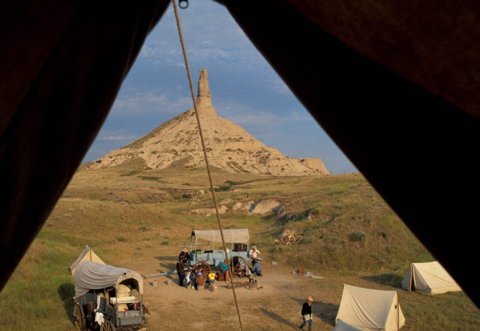 Photo: Wagons stop at Chimney Rock in Nebraska as part of a recreation of the Oregon Trail journey.
