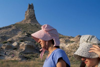 Photo: Participants in an Oregon Trial re-enactment trip at the foot of Chimney Rock in Nebraska.