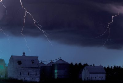 Photo: Lightning strikes near a Nebraska farmstead.