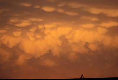Photo: A cyclist under storm clouds at Holmes Lake Dam in Lincoln, NE.