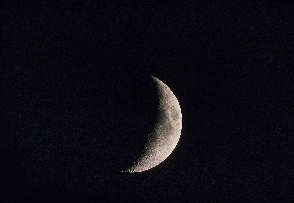 Photo: Crescent moon over the J. Clark Salyer National Wildlife Refuge in ND.