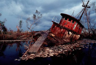 Photo: A boat ruined during Hurricane Andrew, surrounded by hundreds of fish killed during the storm in Louisiana.