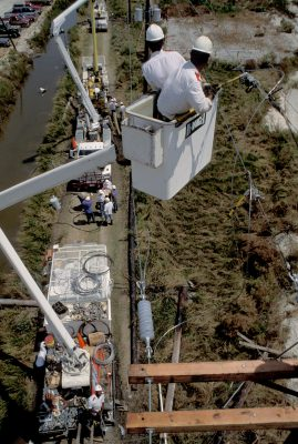 Photo: Power crews work on bucket cranes to restore power along Highway 56 in Cocodrie, Louisiana after Hurricane Andrew.