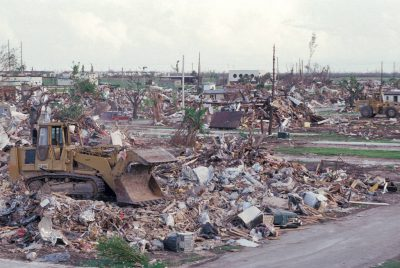 Photo: Bulldozers sit idle among the debris left by Hurricane Andrew.