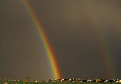 Photo: Two rainbows cross the dark sky after a storm in Utah.