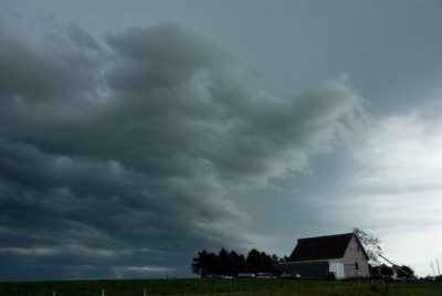Photo: A storm begins near a farmhouse in Iowa.