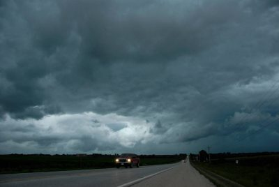 Photo: A storm begins over a highway in Iowa.