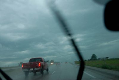 Photo: A storm begins in Iowa, as shown through a car windshield.