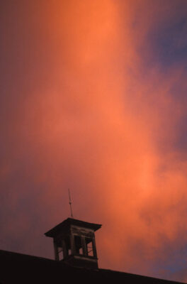 Photo: Storm clouds threaten a lightning rod on the top of a building.