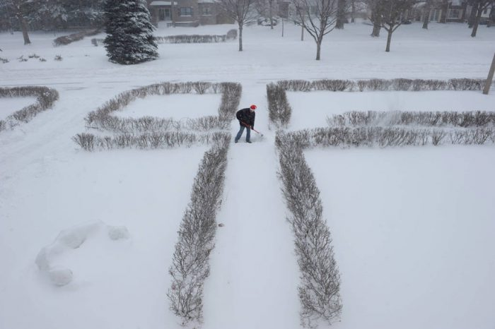Photo: A man shovels snow after a snowstorm in Lincoln, Nebraska.
