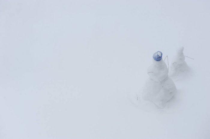 Photo: Snowmen stand stoic in Lincoln, Nebraska.