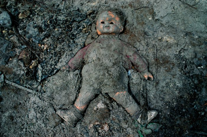 Photo: Mud-covered doll at a south Florida landfill, where debris from the storm were taken.