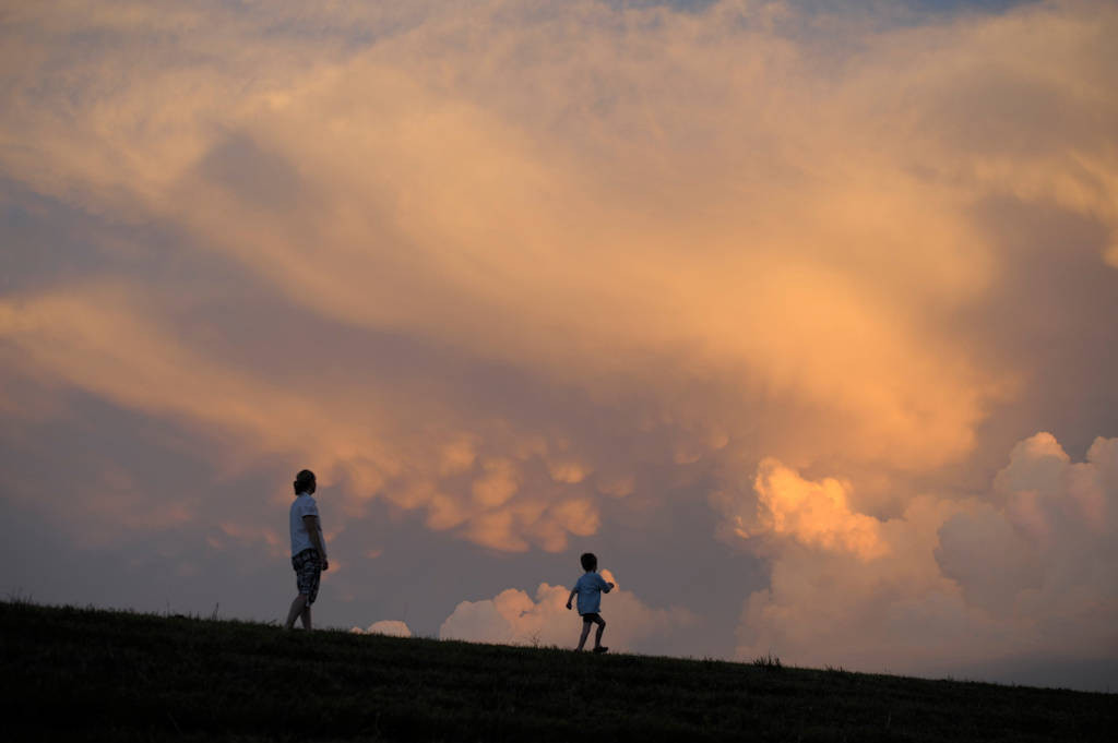 Photo: A mother and son atop Holmes Lake Dam in Lincoln, Nebraska, with a huge thunderstorm in the background.