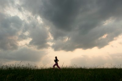 Photo: A young girl runs in a grassy field near Loma, Nebraska.