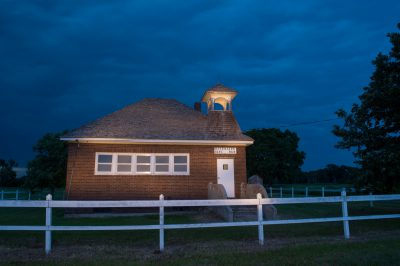 Photo: A one room school house at night.