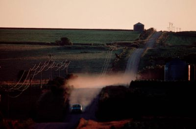 Photo: A farm truck rumbles down a dirt road near Edison, NE.