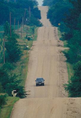 Photo: A truck ambles down a dirt road in eastern Nebraska.