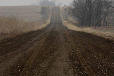 Photo: A muddy, misty spring morning on a minimum maintenance road in Lancaster County, Nebraska.