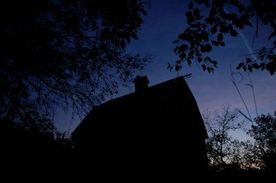 Photo: An original historic peg barn is lit at twilight at Thornhill Farm near Princeton, NE.