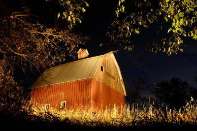 Photo: An original, historic peg barn is lit at twilight at Thornhill Farm near Princeton, NE.