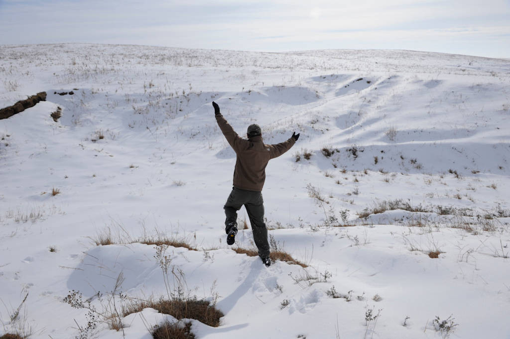 Photo: A man stands in a snowy pasture near Valparaiso, NE.