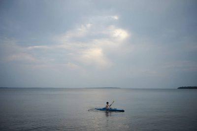 Photo: A boy kayaks on Leech Lake near Walker, MN.