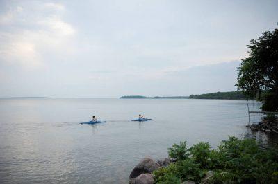 Photo: Two boys kayak on Leech Lake near Walker, MN.