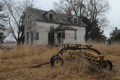 Photo: An old farmstead and farm equipment.