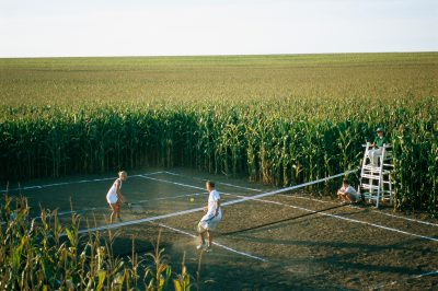 Photo: A game of tennis is played on a tennis court carved from a corn field.
