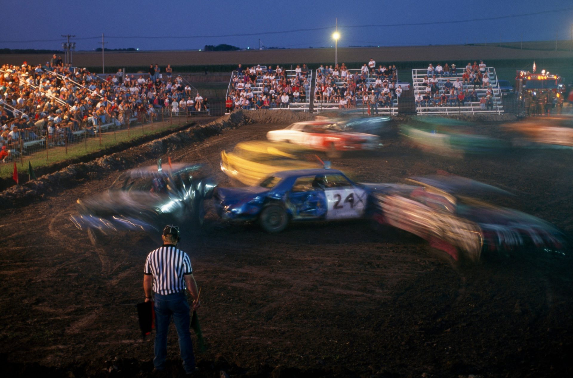 Photo: Local people watch a demolition derby at the Phelps County Fair.