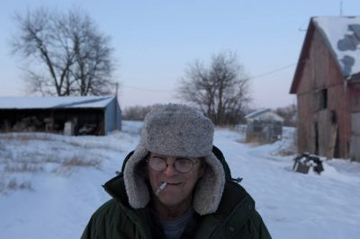 Photo: A man smokes on a cold winter day in Dunbar, Nebraska.