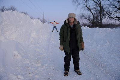 Photo: Two men stand in snow on a winter day in Dunbar, Nebraska.