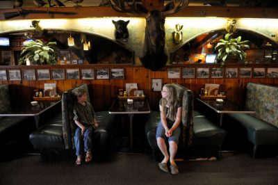 Photo: Two children inside Ole's Big Game Bar and Grill in Paxton, Nebraska.