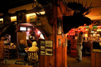 Photo: Patrons share space with stuffed animals at Ole's Big Game Bar and Grill in Paxton, Nebraska.