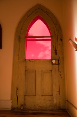 Photo: A sky appears eerily through a red window near Dunbar, Nebraska.