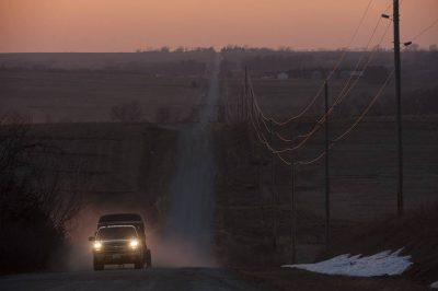 Photo: A truck drives at sunset along a rural road in Nebraska.