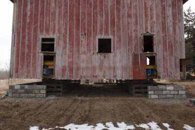 Photo: A barn is set down upon a foundation made of rough-faced blocks.