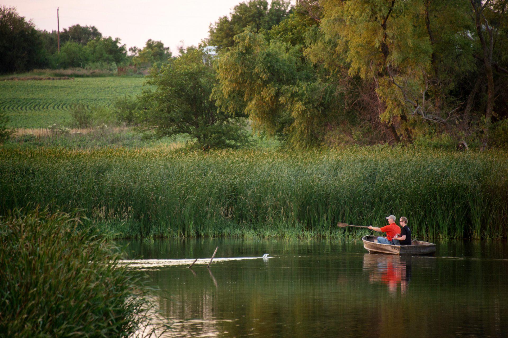 Photo: Two men fishing in a boat near Bennet, Nebraska.