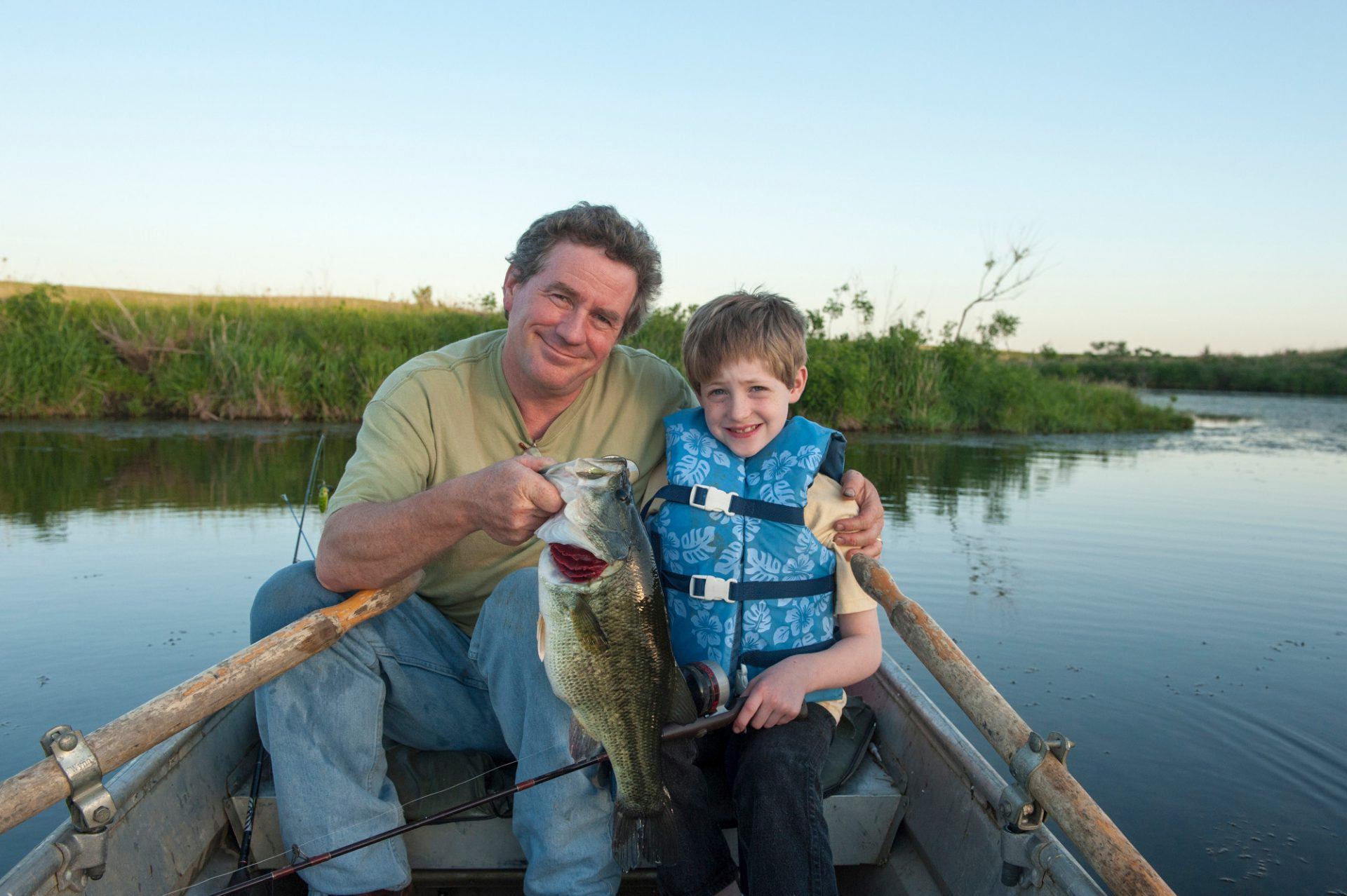 Photo: A father and son catch a fish out of a pond near Valparaiso, Nebraska.