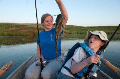 Photo: A brother and sister catch a channel catfish from a farm pond near Valparaiso, Nebraska.
