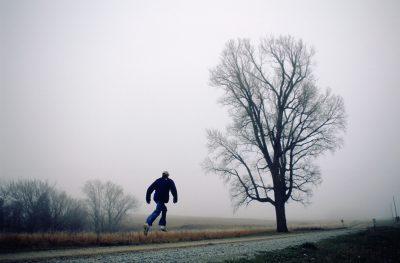 Photo: A man leaps in the air on a gravel road near Walton, Nebraska.