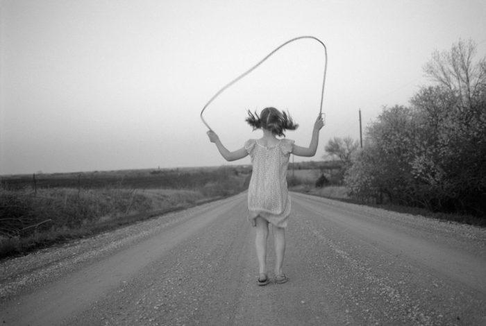 Photo: A girl jumps rope down a gravel road in Nebraska.