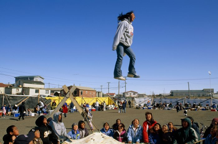 Photo: Inuits enjoy a traditional tossing game.